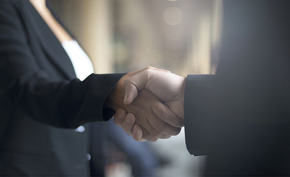 Picture of two business men shaking hands.
